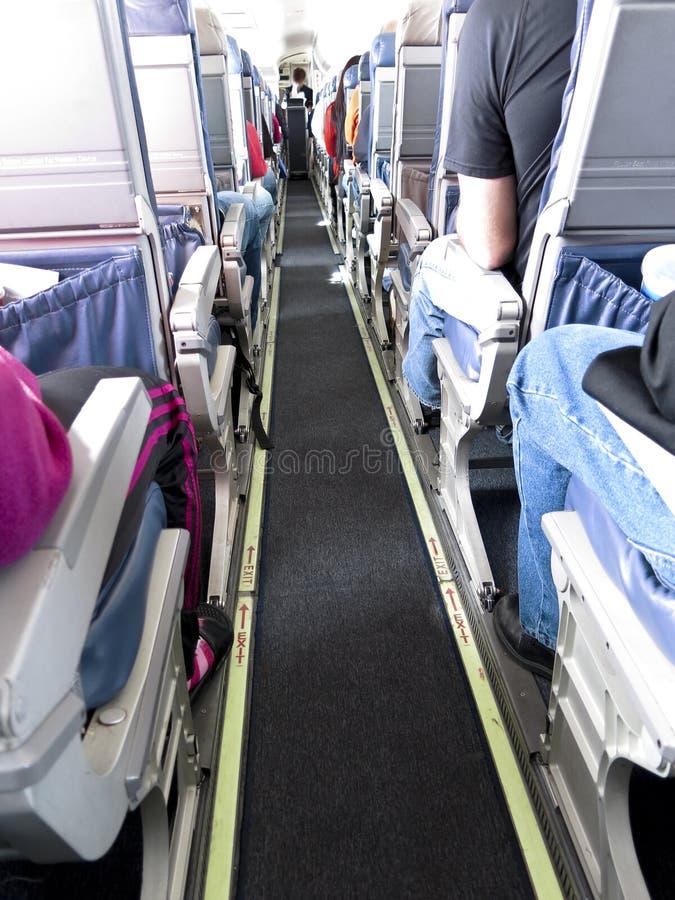 Mensenreis op Passagier Jet Airliner stock afbeelding