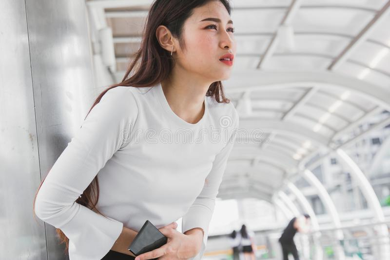Menstrual Pain or Dysmenorrhea stomach ache. Menstrual Pain or Dysmenorrhea office Asian woman stomach ache royalty free stock image