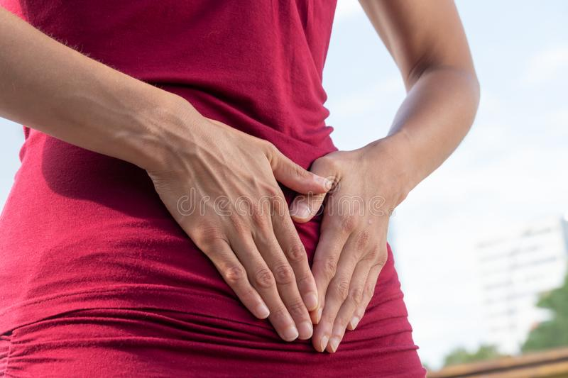 Menstrual pain. Stomach ache. Woman with menstrual or abdominal pain royalty free stock photos