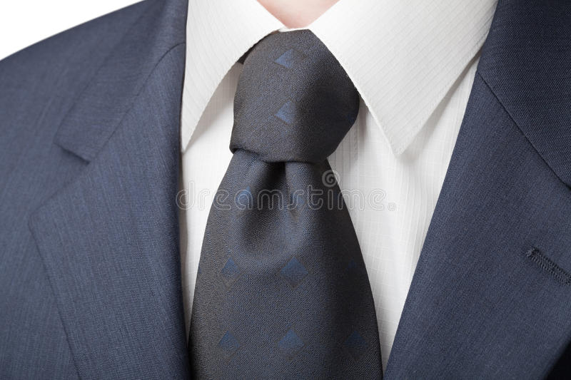 Menswear. Business daily menswear: shirt, tie and jacket. Chemise has the texture of the cell royalty free stock images
