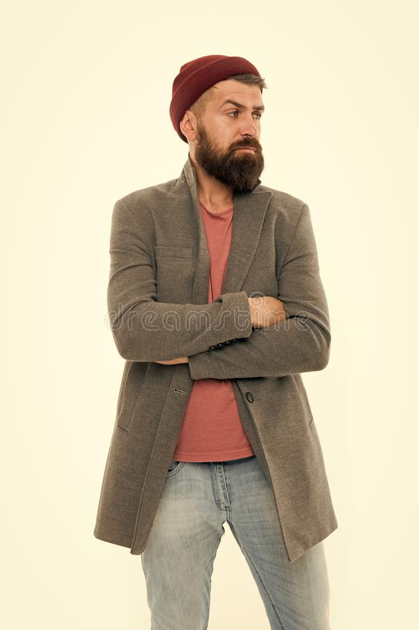 Menswear and fashion concept. Man bearded hipster stylish fashionable coat and hat. Stylish outfit hat accessory. Pick. Matching clothes. Find outfit style you stock photography