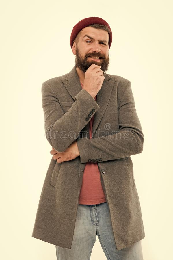 Menswear and male fashion concept. Man bearded hipster stylish fashionable coat and hat. Stylish outfit hat bright. Accessory. Fashion trend outfit. Stylish royalty free stock photography