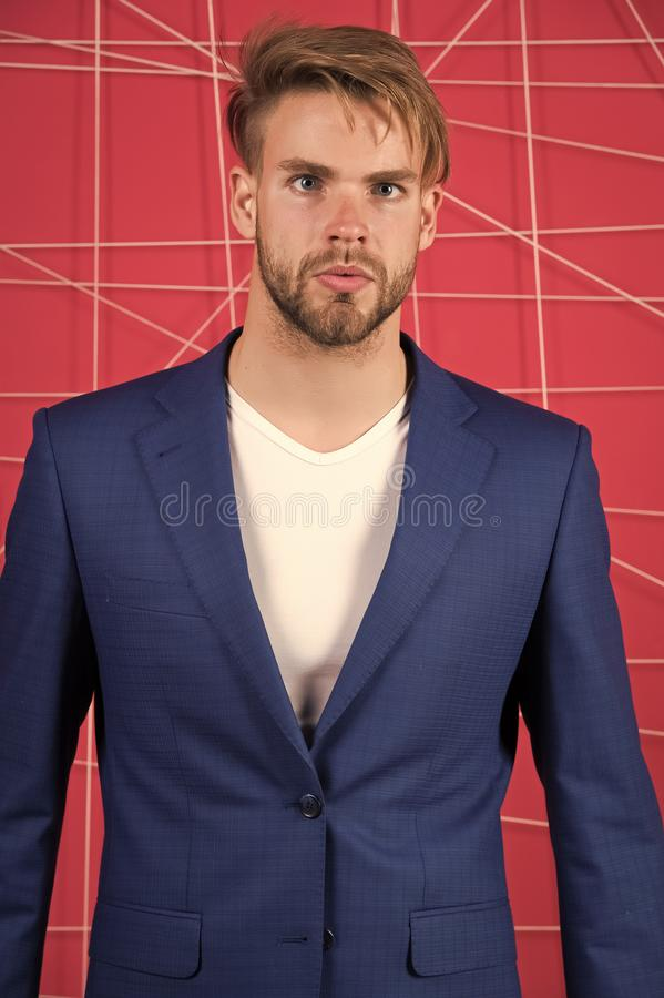 Menswear and stylish wardrobe concept. Man or businessman wear classic dark blue suit. Male fashion. Man formal clothing. Looks handsome and confident. Proper royalty free stock image