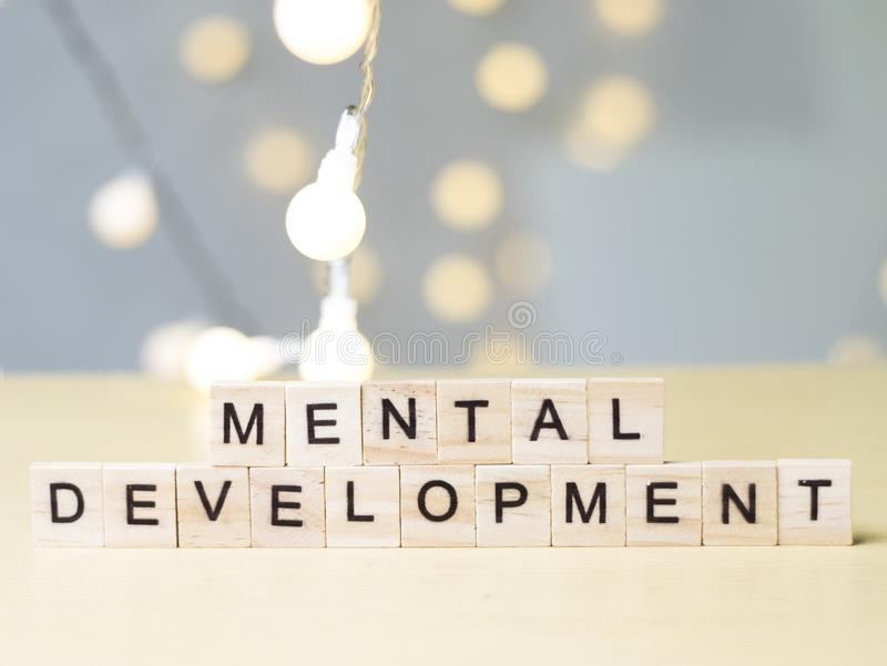 Mental Development. Words Typography Concept. Mental Development, personal education self cognitive psychology development concept, wooden words typography top stock images