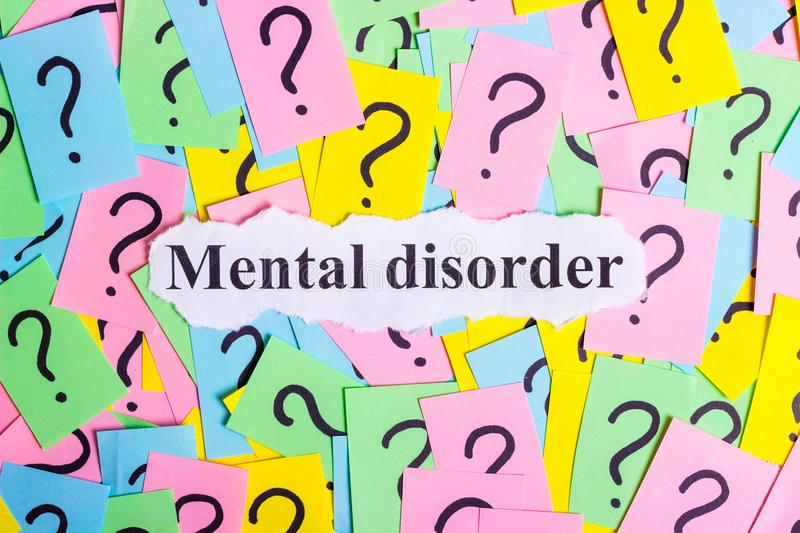 Mental Disorder Syndrome text on colorful sticky notes Against the background of question marks.  royalty free stock photo