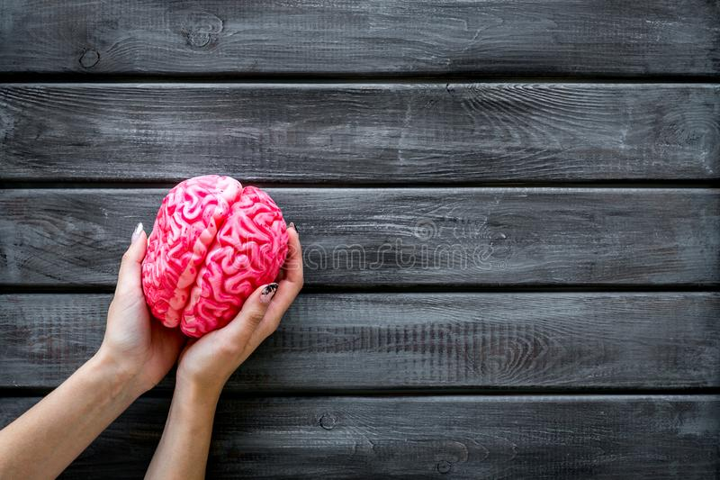 Mental health concept with brain in hands on wooden background top view space for text. Brain functions. Mental health concept with brain in hands on wooden royalty free stock images