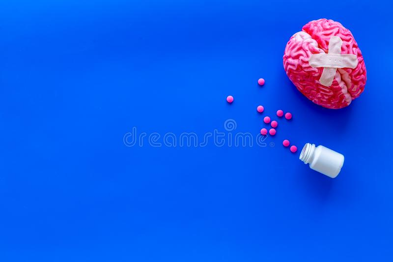 Mental health concept with brain with patches and pills on blue background top view space for text. Brain functions. Mental health concept with brain with stock photo