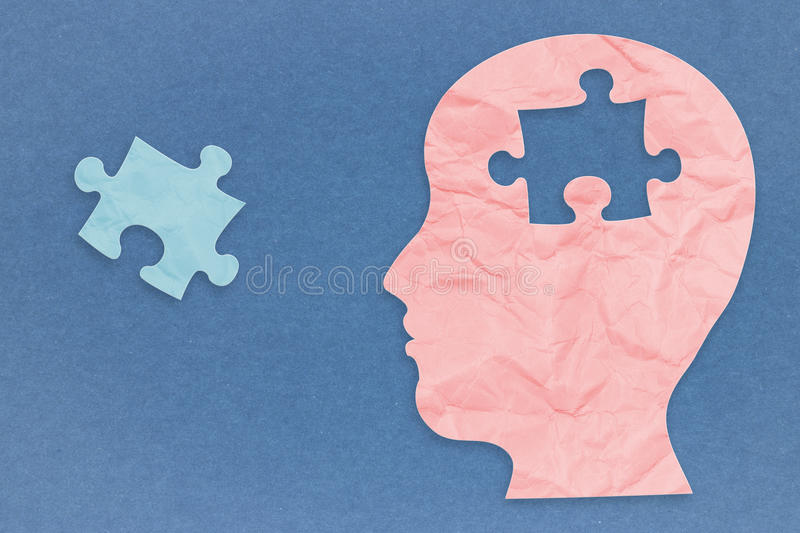 Mental health concept. With side face and jigsaw pieces royalty free stock photography