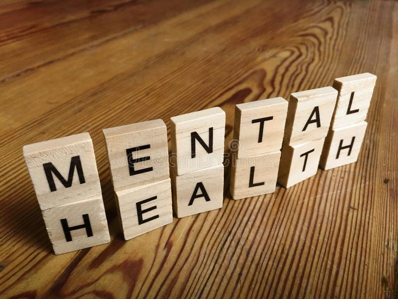 Mental Health concept - sign on wooden floor made of letters. Mental Health concept - sign on wooden floor made of wooden letters royalty free stock images