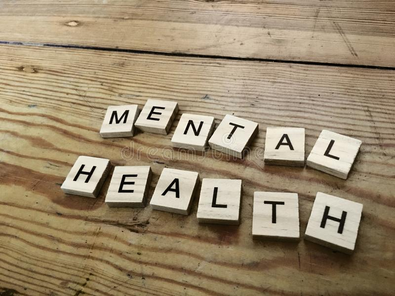 Mental Health concept - sign on wooden floor made of letters. Mental Health concept - sign on wooden floor made of wooden letters royalty free stock photography