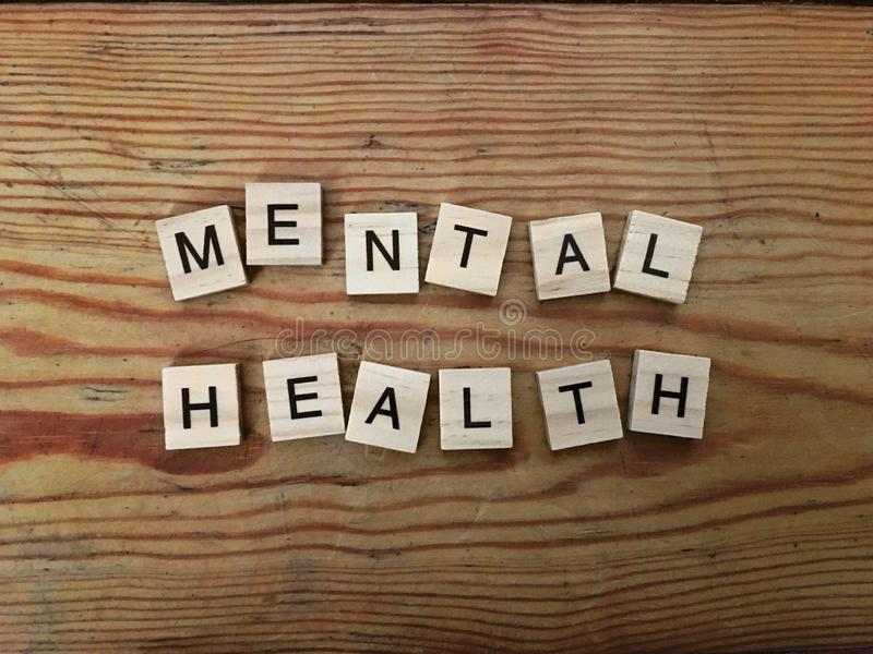 Mental Health concept - sign on wooden floor made of letters. Mental Health concept - sign on wooden floor made of wooden letters royalty free stock photos