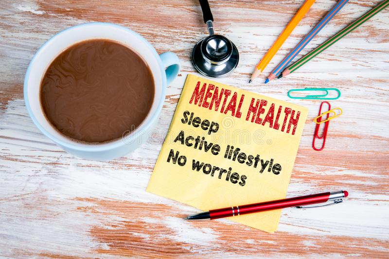 Mental health concept. Text on a napkin. With a cup of coffee royalty free stock image