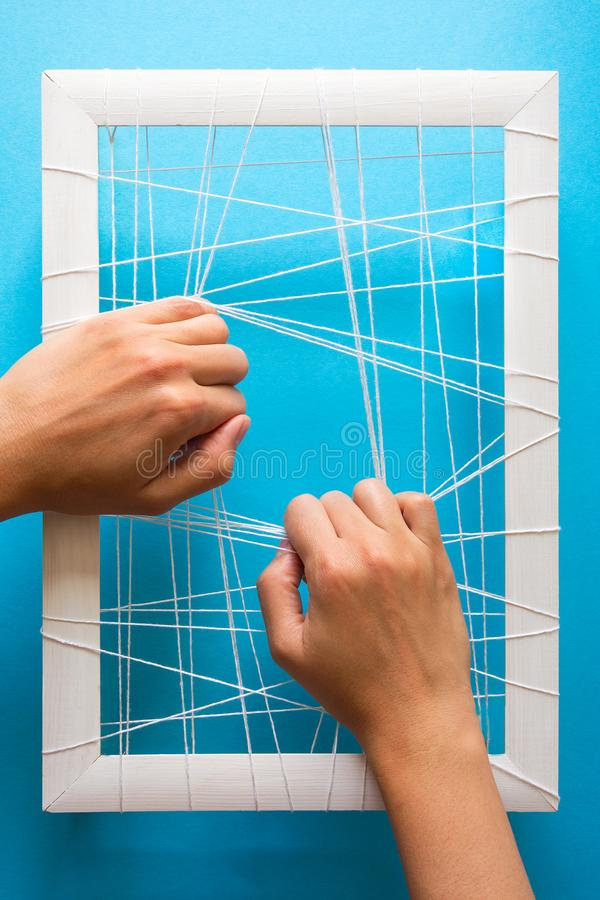 Mental health concept. Women`s hands try to break the fetters on blue background.  stock photos