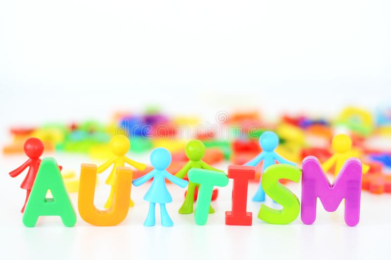 Mental health disorder, autism word with colored toys figurine on white background royalty free stock image