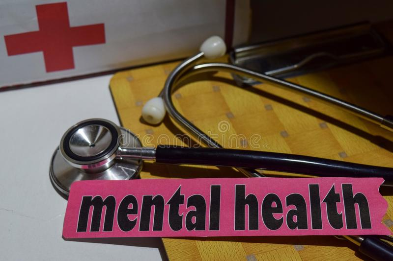 Mental health on the print paper with medical and Healthcare Concept. Inspiration. stethoscope, first aid kit royalty free stock photography