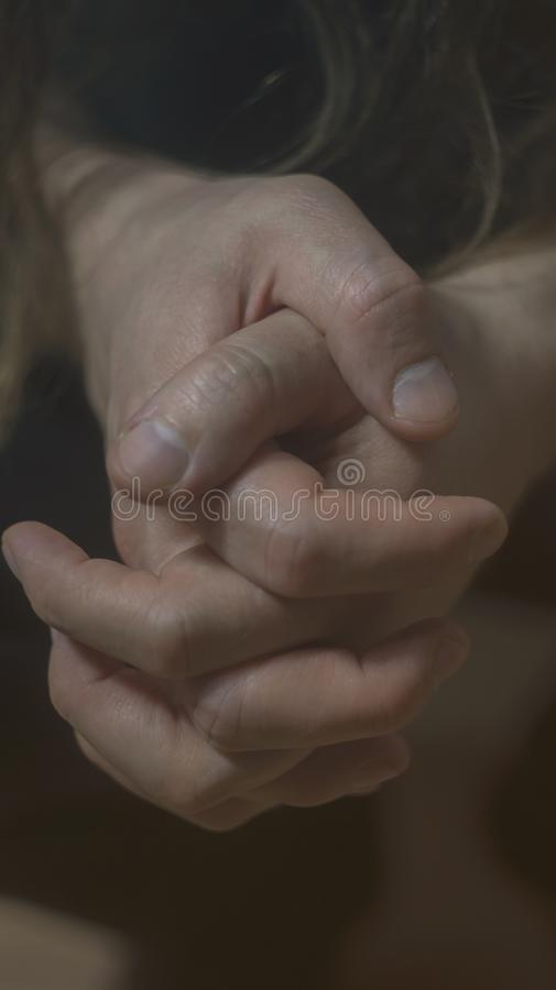 Mental health psychosis depression photo. Close-up hands shrink from nerves. Toning, low key, selective focus. Mental health psychosis and depression photo stock images