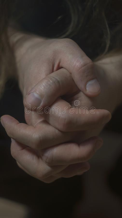 Mental health psychosis depression photo. Close-up hands shrink from nerves. Toning, low key, selective focus. Mental health psychosis and depression photo royalty free stock photo