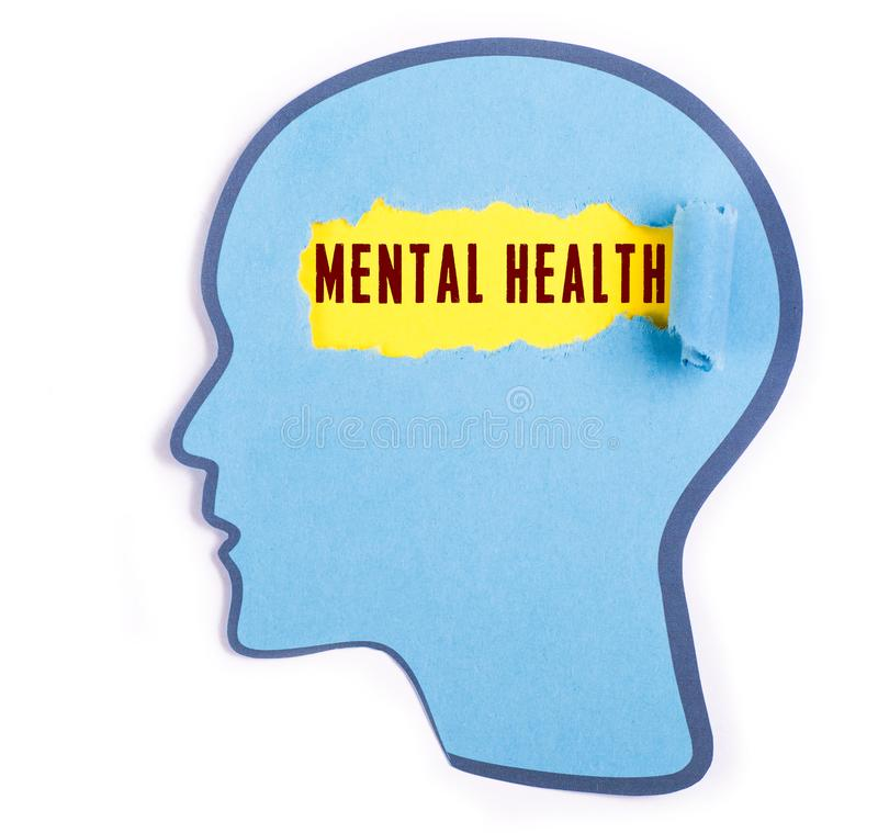 Mental health word in the person head. Torn blue paper and Paper head concept Thoughts inside the brain stock photo