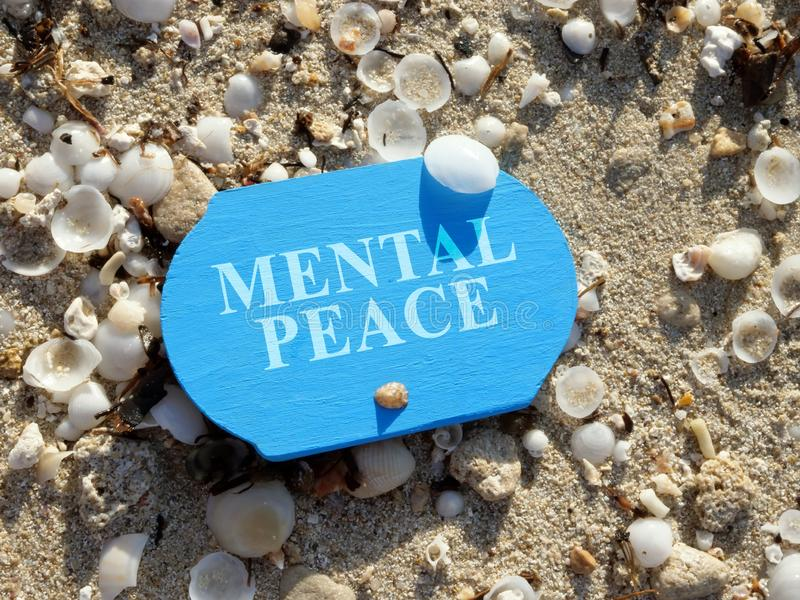 Mental peace sign on the sea shore stock image