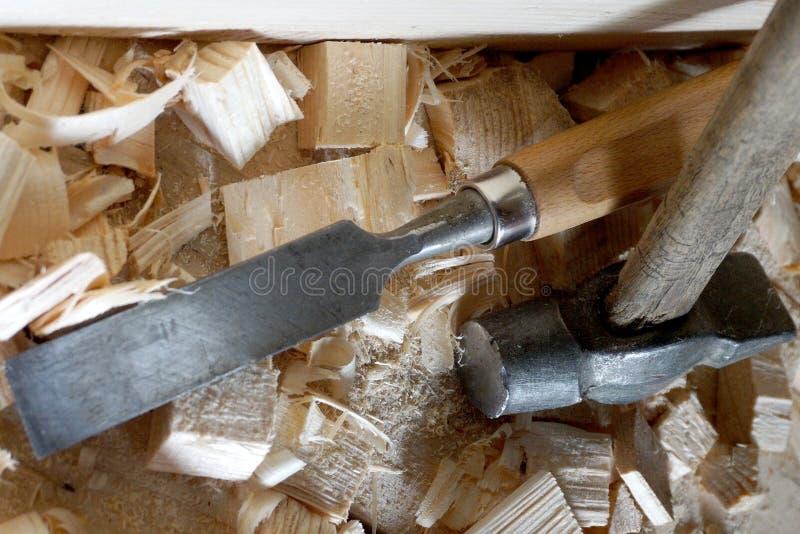 Mentira do martelo e do form?o nas placas foto de stock royalty free