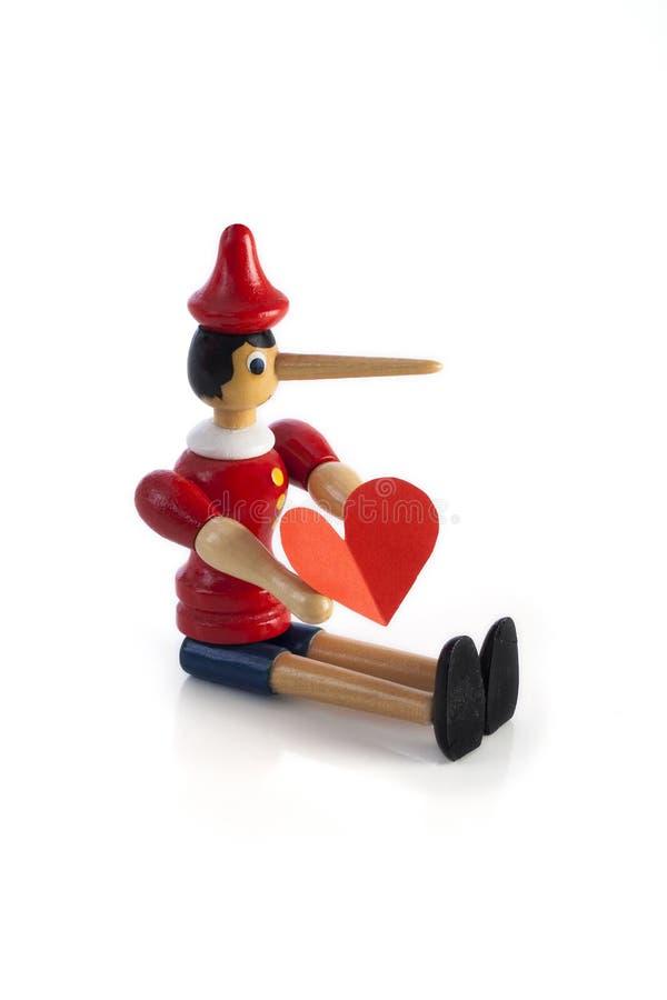 Mentiroso de Pinocchio com coração fotos de stock