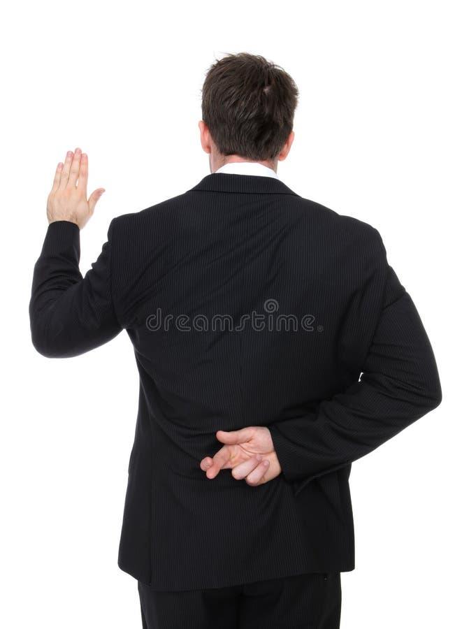 Mentiroso do homem de negócio imagens de stock