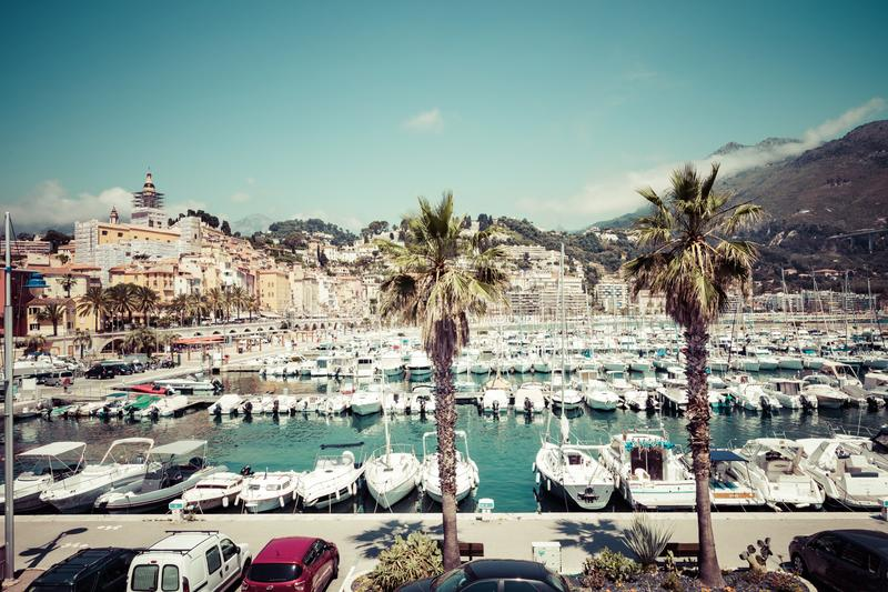 MENTON, FRANCE - JUNE 05, 2019: View of palm tree and harbor with boats in Menton on French Riviera. Provence-Alpes-Cote d`Azur,. France stock photos