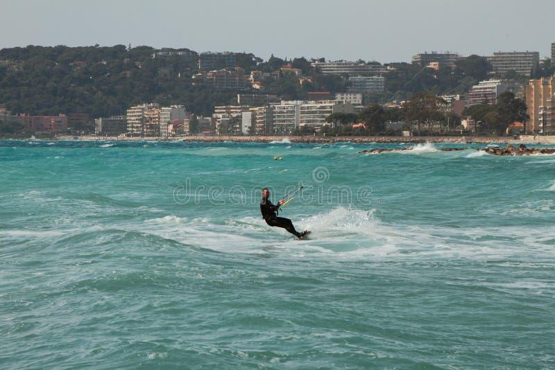 Menton, Nice, France - Apr 20, 2019: Kite surfer in sea. Kite surfer in sea. Menton, Nice, France - Apr 20, 2019 royalty free stock photography