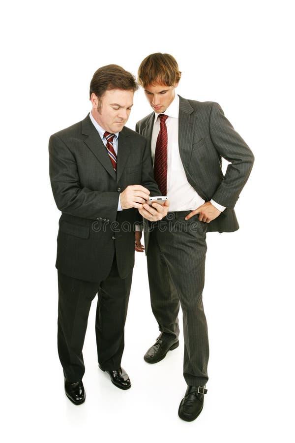Mentor-Serie - Geschäftsmänner u. PDA stockbild