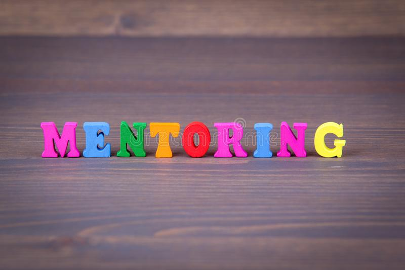 Download Mentoring. Colored Wooden Letters On A Dark Background Stock Photo - Image of career, coach: 102589802