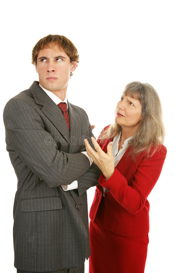 Mentoring Series - Stubborn Employee. Mature businesswoman trying to explain to a stubborn young male employee. Isolated on white stock photo