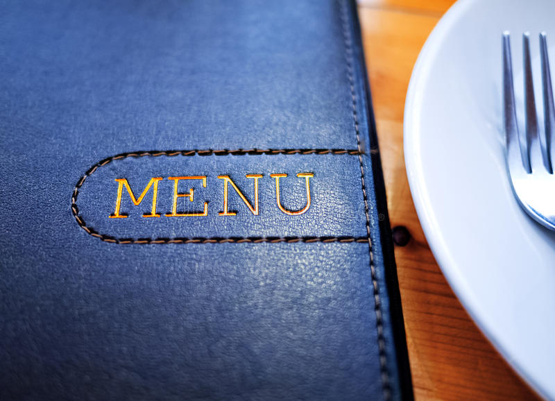 Menu. Black Leather Menu with White Plate on wood table stock photos