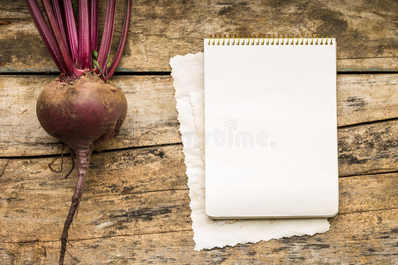 Menu background. Vegetables on table with cook book. Cooking with recipe book. Red beet stock photo