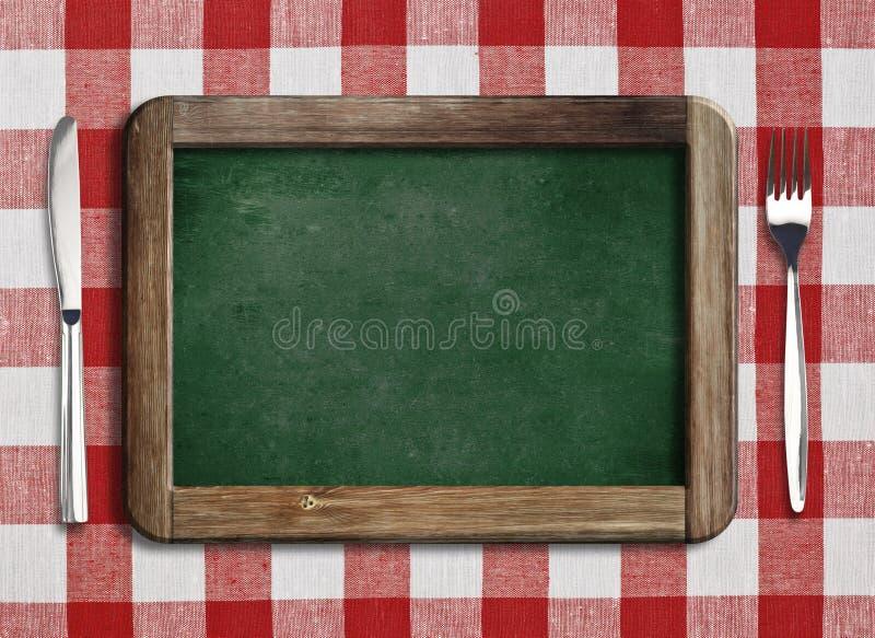 Menu blackboard lying on the beach na stole obraz royalty free