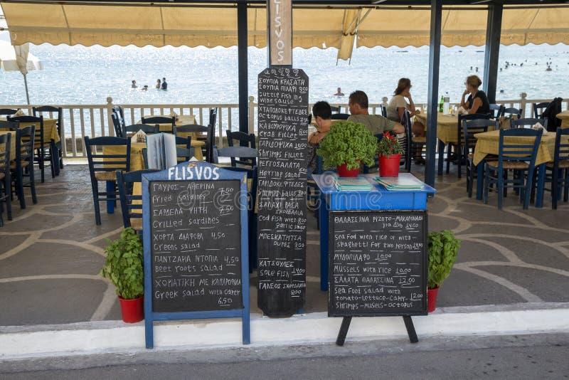 Menu board in front of beach restaurant stock photos