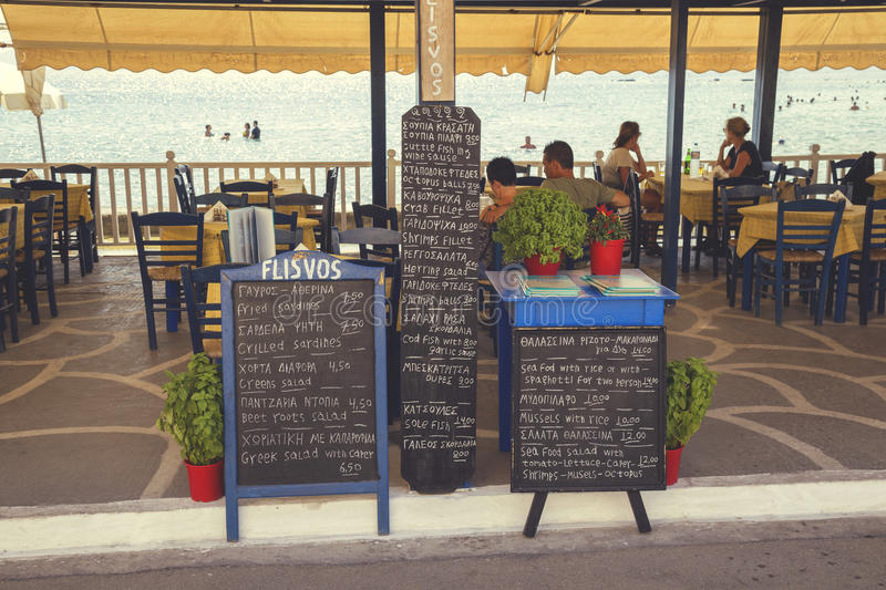 Menu board in front of beach restaurant 4 royalty free stock image
