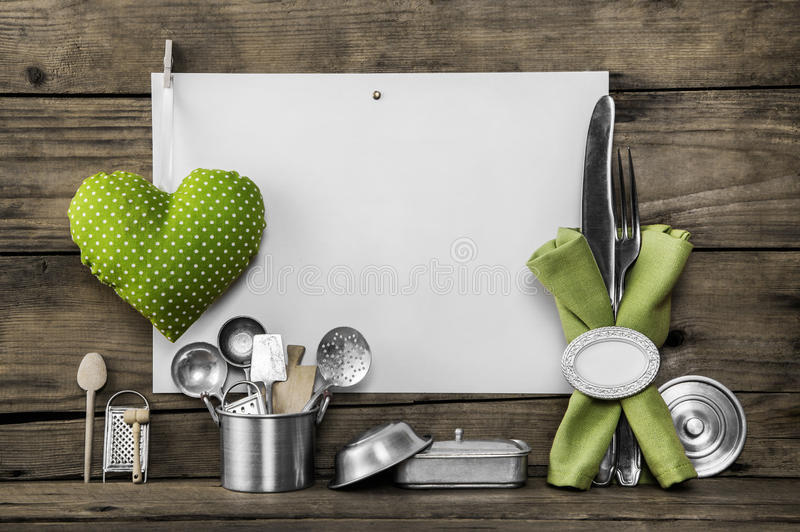 Menu card with old kitchen utensils, white placard, apple green royalty free stock image