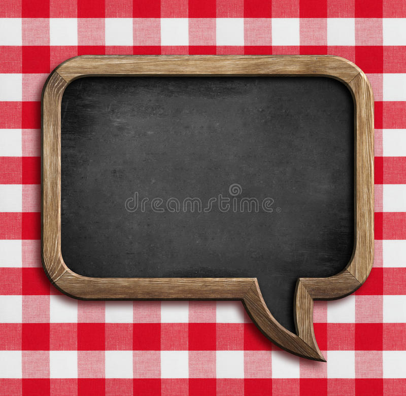 Menu chalkboard speech bubble on picnic tablecloth stock images