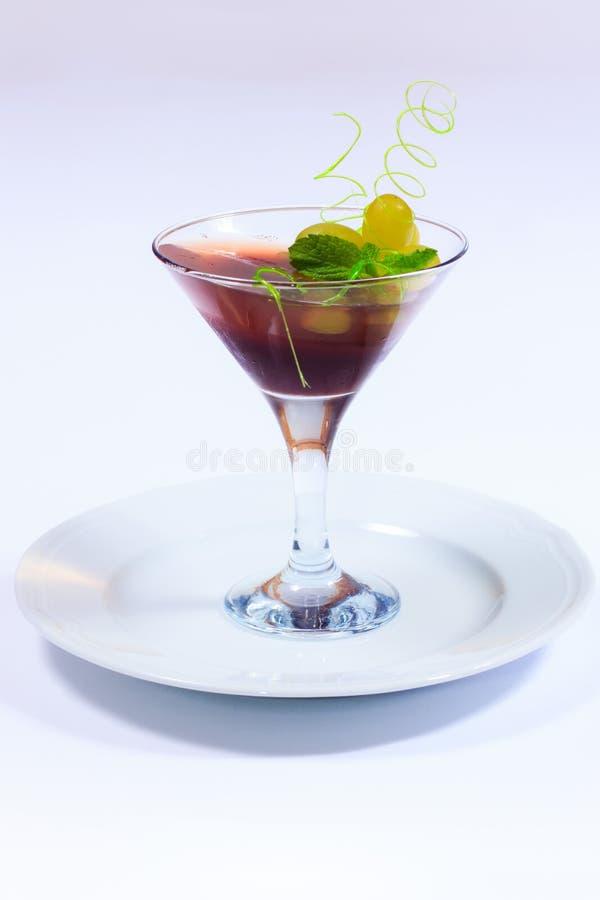 Menu do verão Sobremesa da geleia com uvas imagem de stock