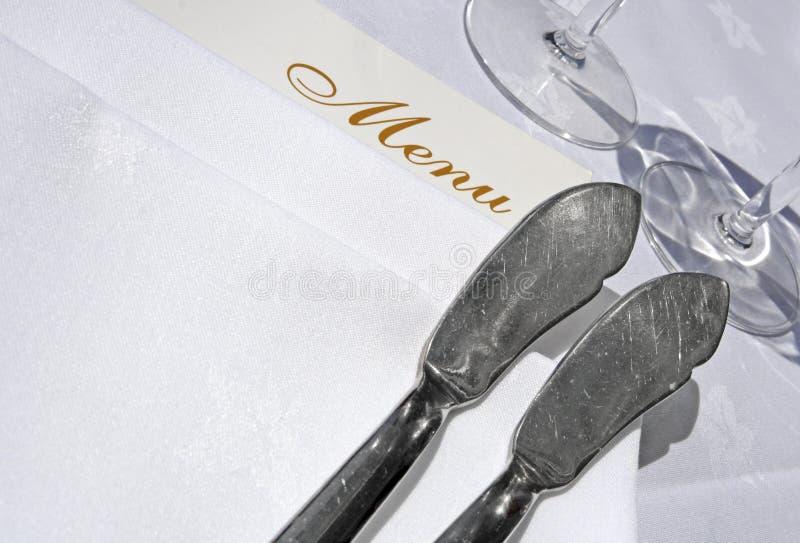 Menu e coltelli da pesce immagini stock