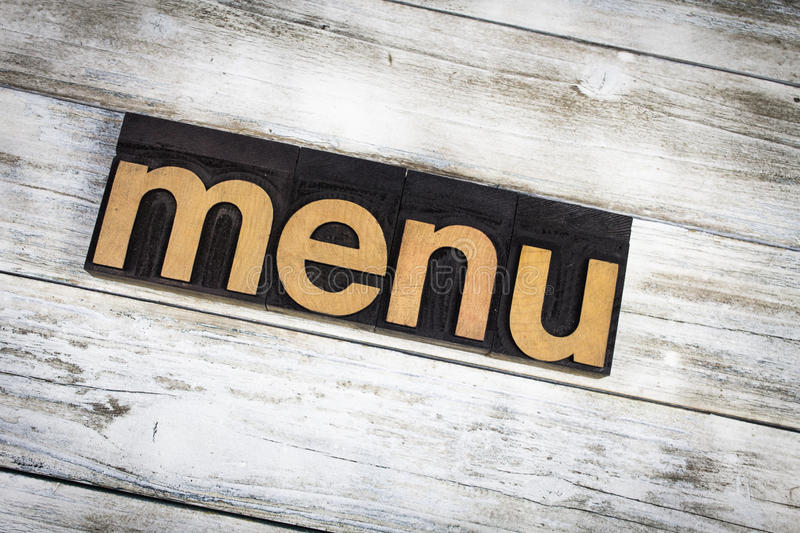 Menu Letterpress Word on Wooden Background stock photography