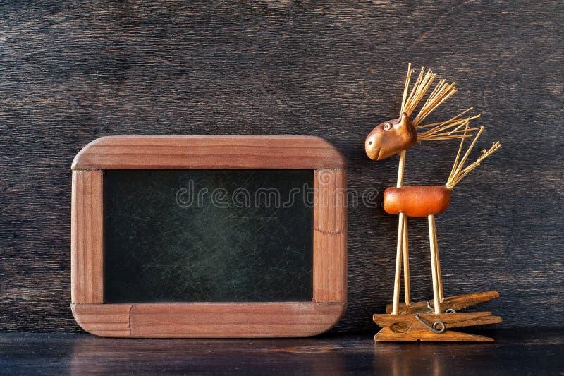 Menuraad, en Uitstekend stuk speelgoed paard stock afbeelding