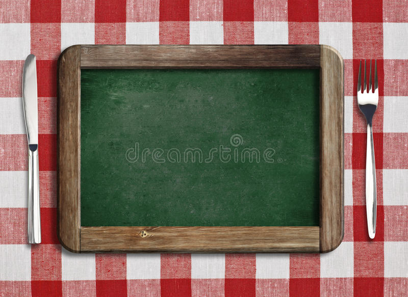 Menyblackboard som ligger på tabellen royaltyfri bild
