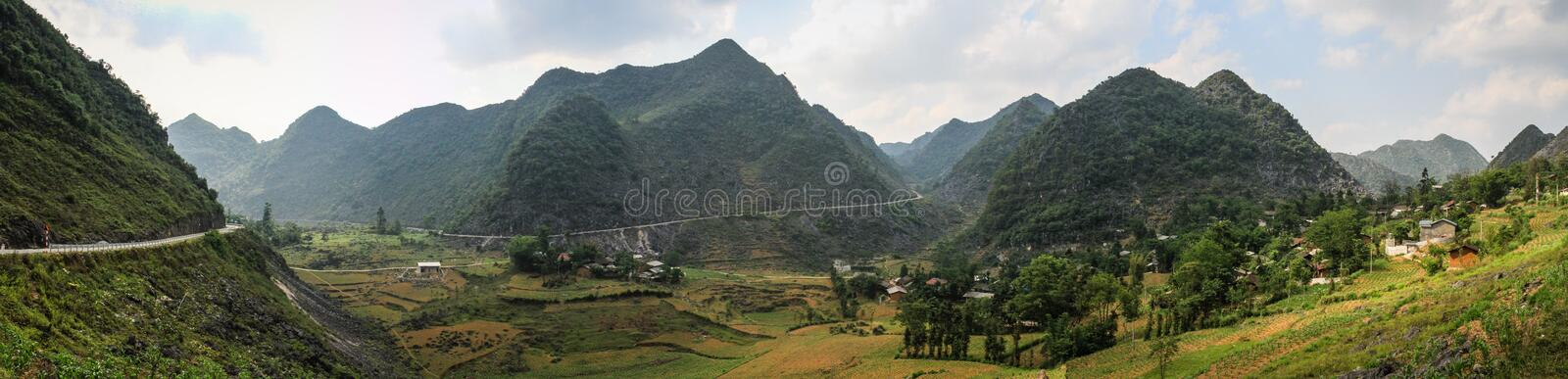 Panorama of the majestic karst mountains around Meo Vac, Ha Giang Province, Vietnam. Meo Vac is a small but charming district capital hemmed in by steep karst stock photo