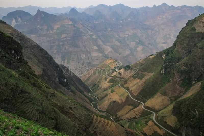 The majestic karst mountains around Meo Vac, Ha Giang Province, Vietnam. Meo Vac is a small but charming district capital hemmed in by steep karst mountains and stock photography