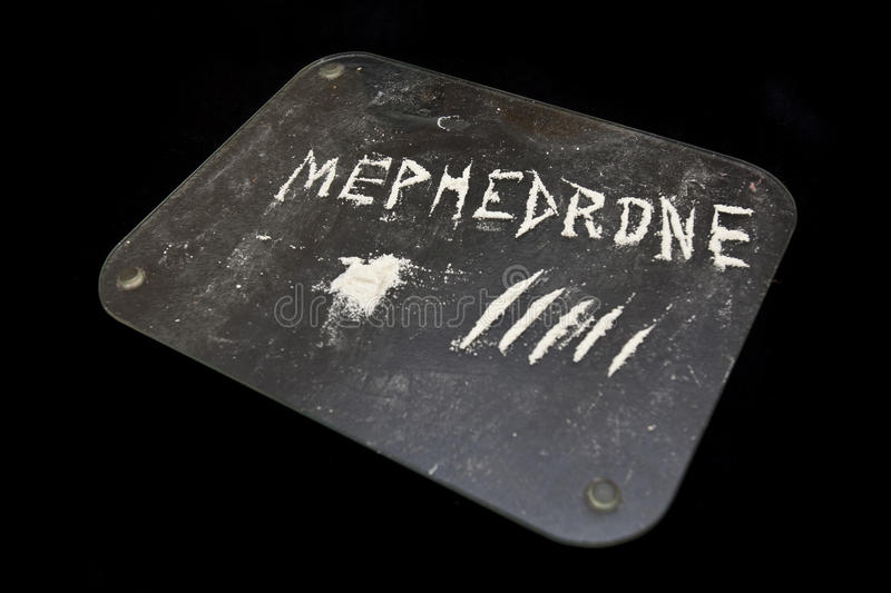 Mephedrone drug. Lines of white powder on a tray with the word Mephedrone next to it stock photo