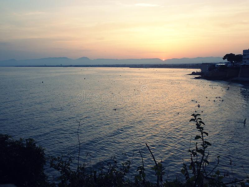 Mer, coucher du soleil image stock