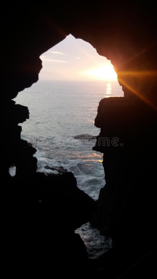 mer de coucher du soleil de Tanger de hercule de grotte images stock