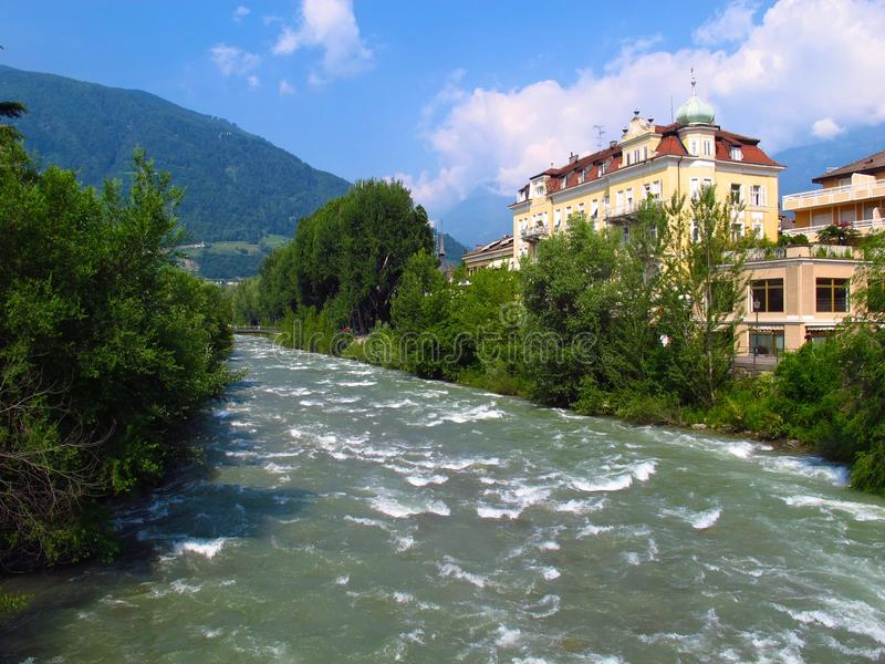 Merano Italy Passer River spring summer Alps. The Passer River rushes through the spa town of Merano in Italy's South Tyrol region royalty free stock images