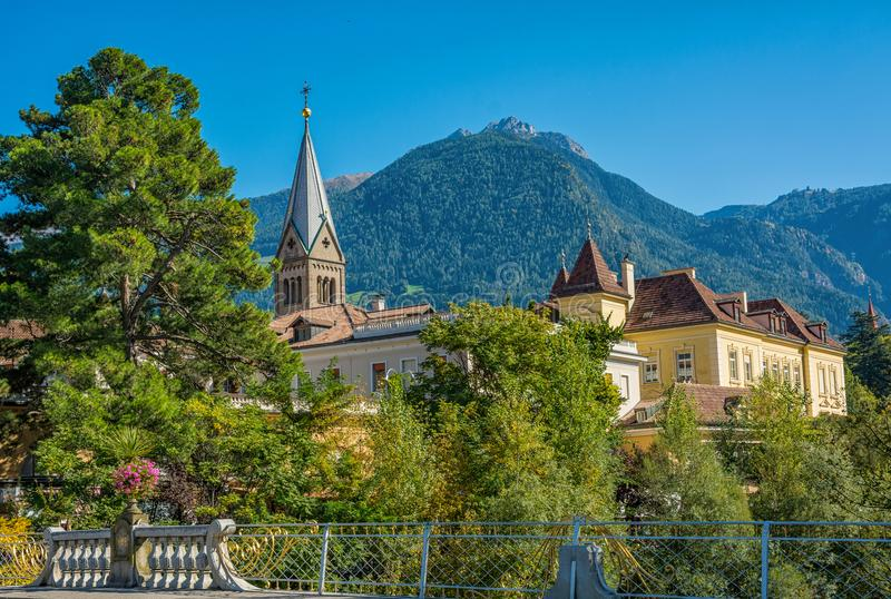 Merano in South Tyrol, a beautiful city of Trentino Alto Adige, View on the famous promenade along the Passirio river. Italy. Merano in South Tyrol, a beautiful stock image